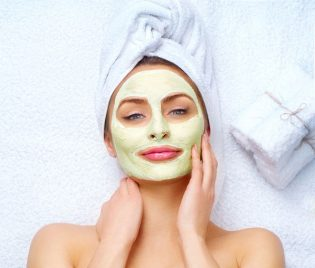 51140722 - spa woman applying facial clay mask