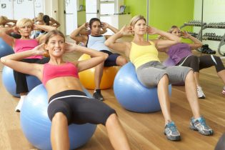 42249050 - women taking part in gym fitness class