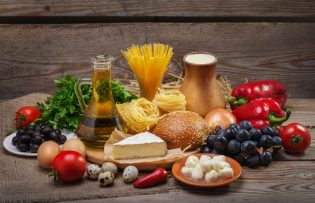47191239 - set of different foods on the old wooden background, vegetables, pasta, fruit, eggs, dairy products, the concept of a balanced diet, the ingredients for italian food