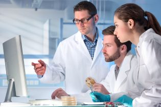 38495348 - group of scientists working at the laboratory