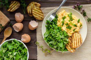 44784397 - scrambled eggs with beans and salad, baked baguette on a panini