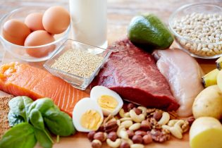 54776181 - balanced diet, cooking, culinary and food concept - close up of different foodstuffs on table