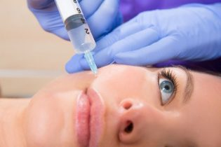 19636953 - anti aging facial mesotherapy with syringe closeup  on woman face