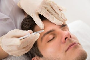 43306532 - young man having botox treatment at beauty clinic