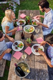 39180034 - group of friends enjoying their outdoor dinner party