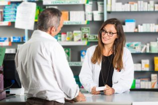 32361211 - pharmacist and client in a drugstore