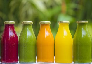 50743374 - organic cold-pressed raw vegetable juices in glass bottles