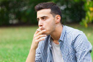 27647700 - man smoking a cigarette outdoor
