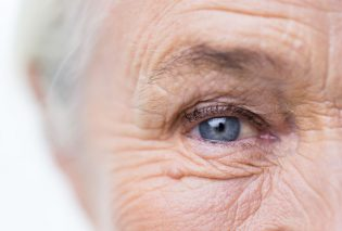 47872544 - age, vision and old people concept - close up of senior woman face and eye
