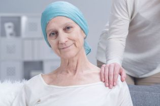 54714062 - sick older woman with cancer with inner strength to fight with disease