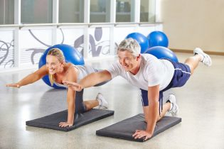 36678128 - man and woman doing gymnastics together in a fitness center