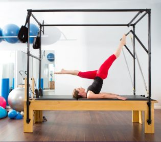 15429333 - pilates aerobic instructor woman in cadillac fitness exercise