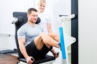 33749205 - patient at the physiotherapy doing physical exercises using leg press in sport remobilization
